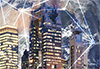 Glowing city skyline overlaying interconnected dots and a view of the earth to represent a global network of buildings.