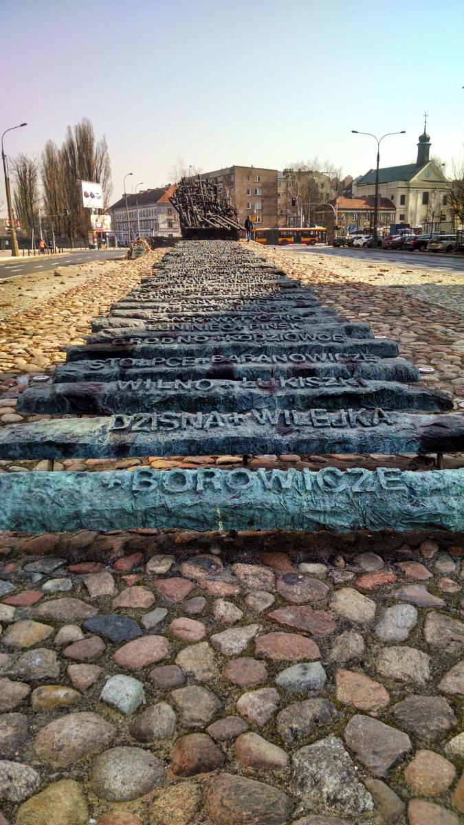 Monument to the Fallen and Murdered in the East, Warsaw, Poland, railroad ties displaying names of sites of Soviet oppression of Poles leading to deathcart